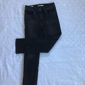 724 High rise straight black Levi's jeans